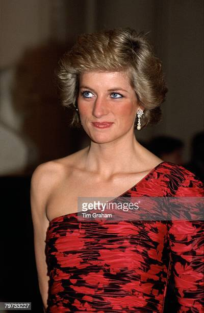 Diana Princess of Wales attending a dinner in Paris hosted by the British Amabassador She is wearing a oneshouldered evening dress by fashion...