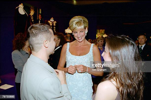 Diana, Princess of Wales, attending a private viewing of the dresses that are for auction and reception at Christie's in aid of the Aids Crisis Trust...
