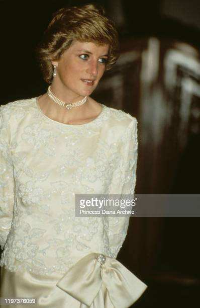 Diana Princess of Wales attends a banquet at Merdeka Palace the presidential palace in Jakarta Indonesia November 1989 She is wearing a white Emanuel...