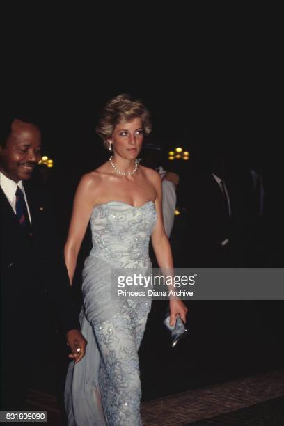 Diana Princess of Wales attends a banquet at the president's palace in Yaounde Cameroon wearing a pastel blue Catherine Walker strapless evening gown...