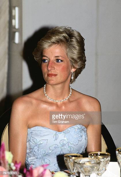 Diana Princess of Wales attends a banquet in Cameroon The Princess is wearing diamond and pearl earrings which were a wedding gift form the Amir of...
