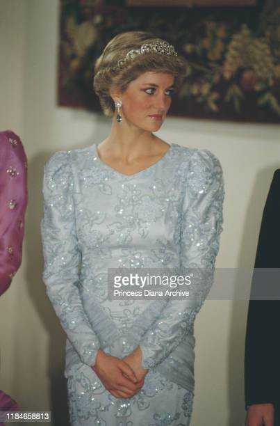 Diana, Princess of Wales attends a banquet in Munich, Germany, wearing an evening dress by Catherine Walker and the Spencer family tiara, November...