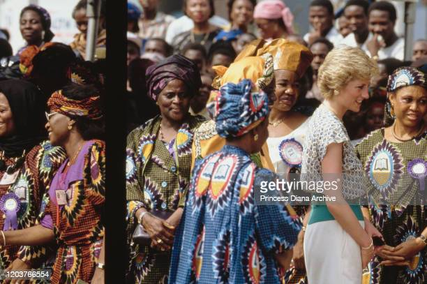 Diana, Princess of Wales attends a Better Life For Rural Dwellers women's fair in Tafawa Balewa Square, Lagos, Nigeria, March 1990. She is wearing a...