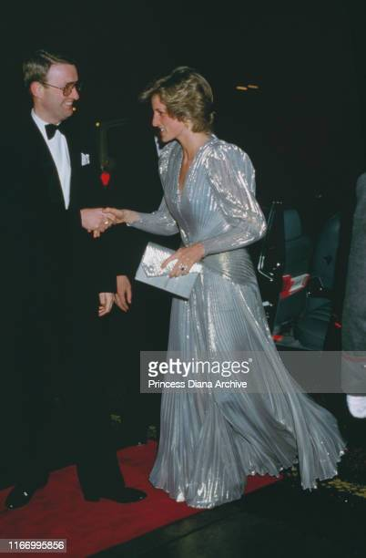 Diana, Princess of Wales attends a Bruce Oldfield fashion show at the Grosvenor House Hotel in London, wearing a dress by Oldfield, March 1985.