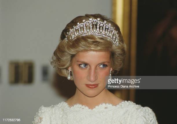 Diana, Princess of Wales attends a dinner at the British Embassy in Washington, DC, November 1985. She is wearing an evening dress by Murray Arbeid...