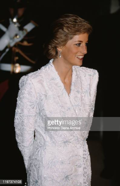 Diana, Princess of Wales attends a dinner at the Château de Chambord in France, November 1988. She is wearing a white beaded evening dress by...