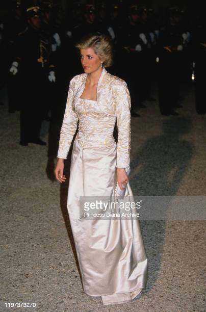 Diana, Princess of Wales attends a dinner at the Élysée Palace in Paris, France, November 1988. She is wearing a white gown by Victor Edelstein with...