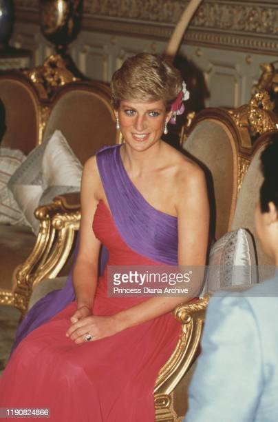 Diana Princess of Wales attends a dinner hosted by the Crown Prince in Bangkok Thailand February 1988 She is wearing an evening dress by Catherine...