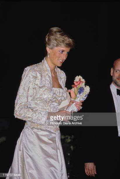 Diana, Princess of Wales attends a gala dinner at the Winter Garden in New York City, USA, 2nd February 1989. She is wearing a white beaded gown by...