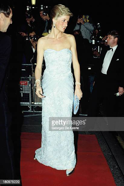 Diana, Princess of Wales, attends a Moulin Rouge performance at The Savoy Hotel on March 9, 1989 in London, England. The princess wears a strapless...