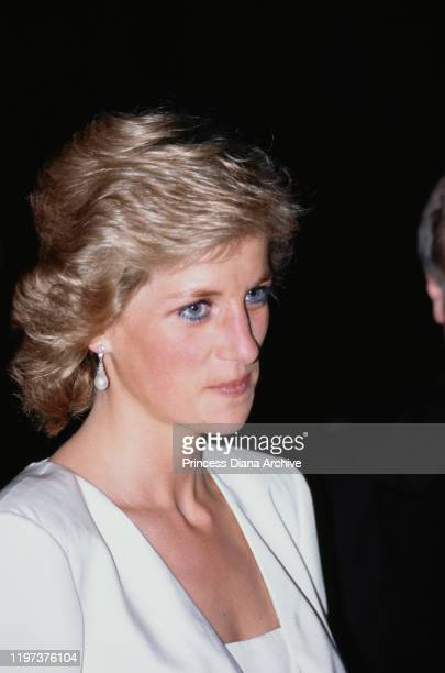 Diana, Princess of Wales attends a performance of 'Swan Lake' by the Bolshoi Ballet at the London Coliseum, 27th July 1989. She is wearing a pink and...