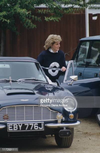 Diana, Princess of Wales attends a polo match at the Guards Polo Club on Smith's Lawn, Windsor, May 1986. She is getting out of Prince Charles' Aston...