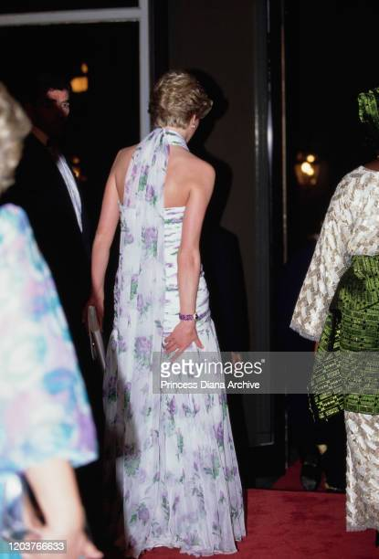 Diana, Princess of Wales attends a presidential banquet hosted by Nigerian President Ibrahim Babangida in Lagos, Nigeria, March 1990. She is wearing...