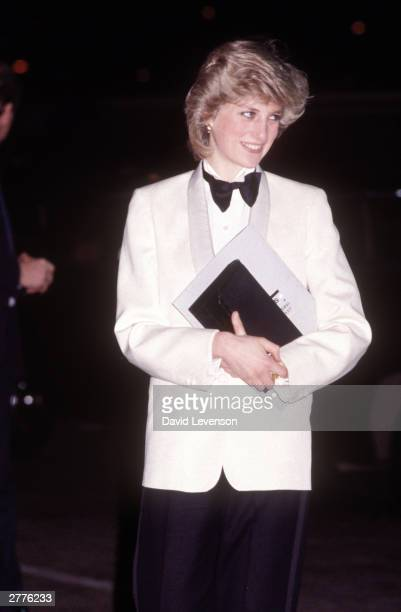 Diana Princess of Wales attends a rock concert by Genesis on February 29, 1984 at the National Exhibition Centre in Birmingham. Diana wore a tuxedo...