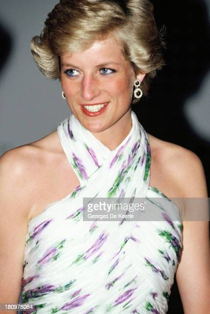 Diana Princess of Wales attends a State Banquet during her official visit to Nigeria on March 15 1990 in Lagos Nigeria The princess wears a Catherine...
