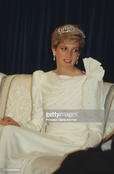 Diana, Princess of Wales attends a state dinner held by the Emir of Bahrain at Al-Qudaibiya Palace in Manama, Bahrain, November 1986. She is wearing...