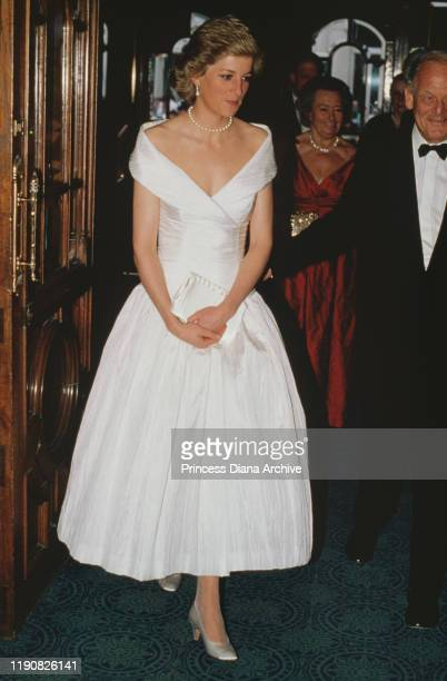 Diana, Princess of Wales attends an English National Opera production of Mozart's 'The Magic Flute' at the London Coliseum, May 1988. She is wearing...