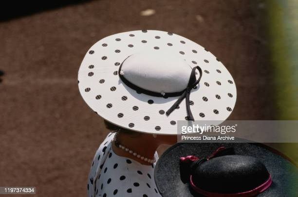 Diana Princess of Wales attends the Ascot race meeting in England wearing a black and white spotted dress by Victor Edelstein and a Philip Somerville...