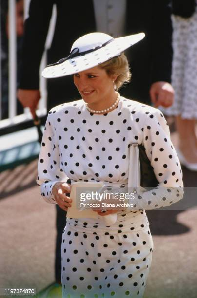 Diana, Princess of Wales attends the Ascot race meeting in England, wearing a black and white spotted dress by Victor Edelstein and a Philip...
