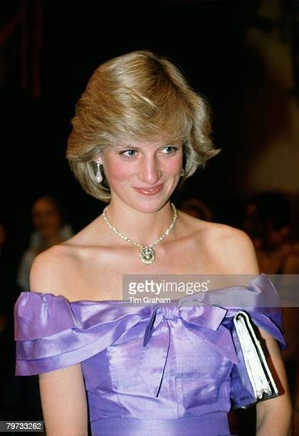 Diana Princess of Wales attends the ballet 'Coppelia' during her official tour of New Zealand The Princess is wearing a mauve evening dress designed...