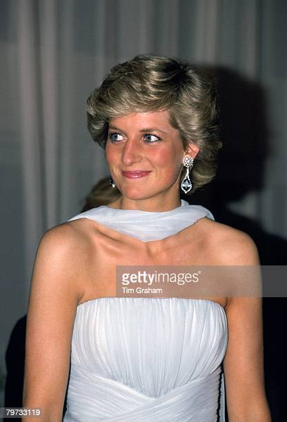 Diana, Princess of Wales attends the Cannes film festival wearing a pale blue chiffon dress and wrap designed by fashion designer Catherine Walker
