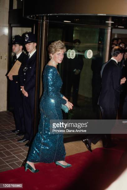 Diana Princess of Wales attends the Diamond Ball at the Royal Lancaster Hotel in London December 1990 She is wearing a sequined evening gown by...
