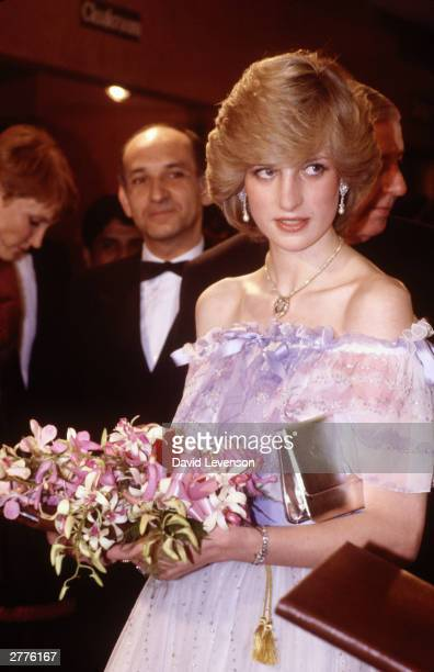 Diana Princess of Wales attends the Film Premiere of Gandhi at the Odeon Leicester Square on December 2 1982 in London Standing to the left of her is...