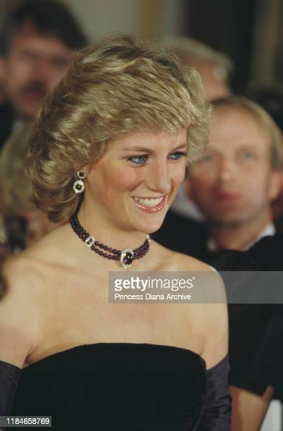 Diana, Princess of Wales attends the opera in Munich, Germany, wearing a purple strapless gown by Catherine Walker, November 1987.