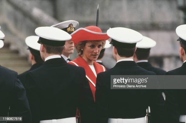 Diana, Princess of Wales attends the passing out parade at the Royal Naval College in Dartmouth, Devon, April 1989. She is wearing a Catherine Walker...