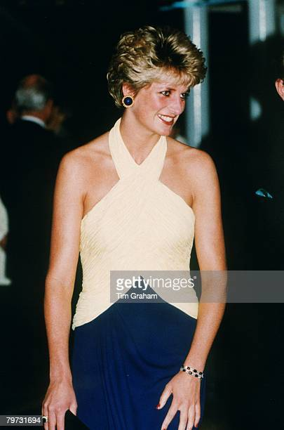 Diana, Princess of Wales attends the premiere of 'Far and Away' at the Leicester Square Empire Cinema, She is wearing a yellow and navy blue halter...