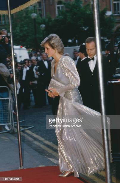 Diana, Princess of Wales attends the premiere of the James Bond film 'A View To a Kill' at the Empire Leicester Square in London, wearing a gold lame...