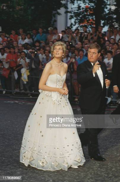 Diana, Princess of Wales attends the premiere of the James Bond film 'The Living Daylights' in London, June 1987. She is wearing an Emanuel dress.