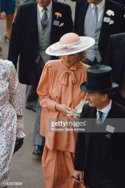 Diana, Princess of Wales attends the racing at Ascot, Berkshire, June 1984. She is wearing a Jan Van Velden suit and a hat by Frederick Fox.