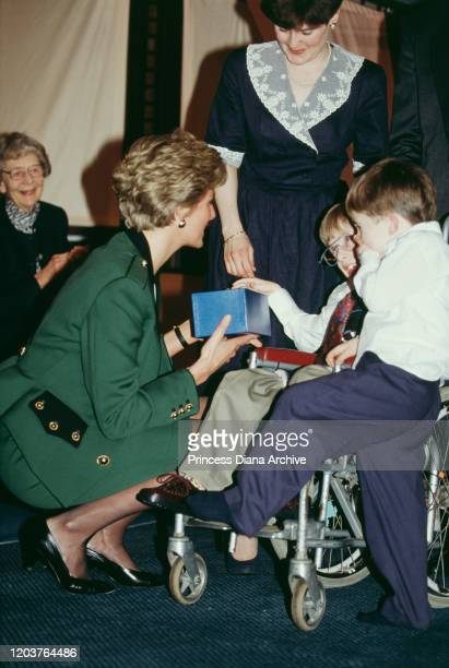 Diana Princess of Wales attends the Relate Family of the Year awards in London March 1991 She is wearing a green suit by Moschino