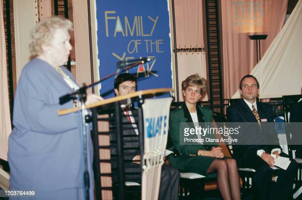 Diana, Princess of Wales attends the Relate Family of the Year awards in London, March 1991. She is wearing a green suit by Moschino.