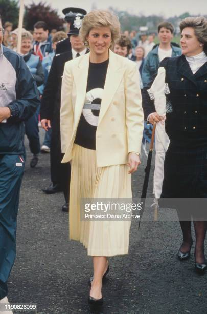 Diana, Princess of Wales attends the start of the London Marathon, 19th April 1988. She is wearing a top with the London Underground symbol on it. On...