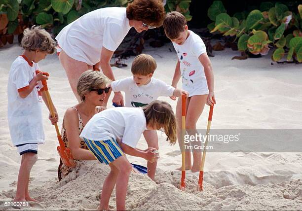 Diana Princess Of Wales Being Buried In The Sand By Her Sons Prince William And Prince Harry And Her Niece And Nephew During A Summer Holiday By The...