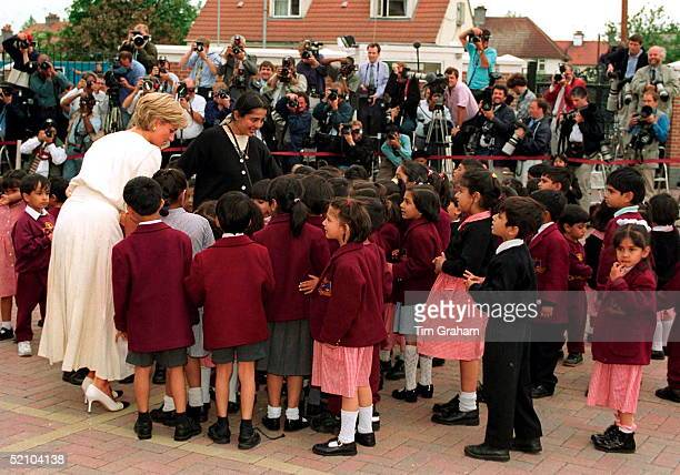 Diana, Princess Of Wales, Being Photographed By Press Photographers As She Meets Some Of The Pupils Of The Swaminarayan School During Her Visit To...