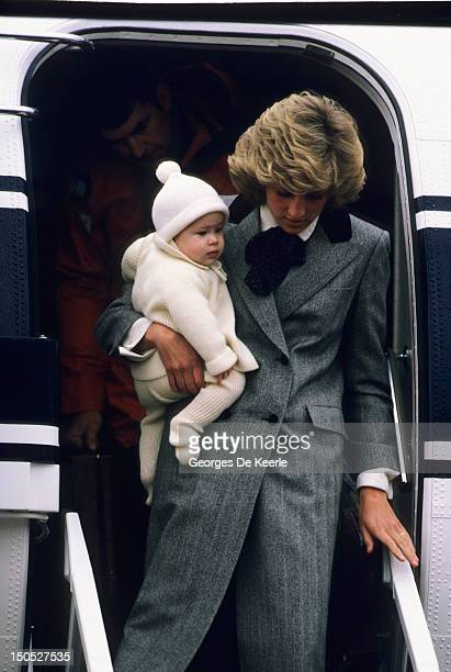 Diana Princess of Wales carries her son Prince Harry off a flight at Aberdeen Airport