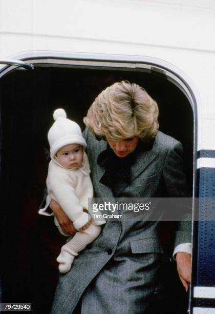 Diana Princess of Wales carries her son Prince Harry off a flight at Aberdeen Airport en route to Balmoral Scotland 22nd March 1985