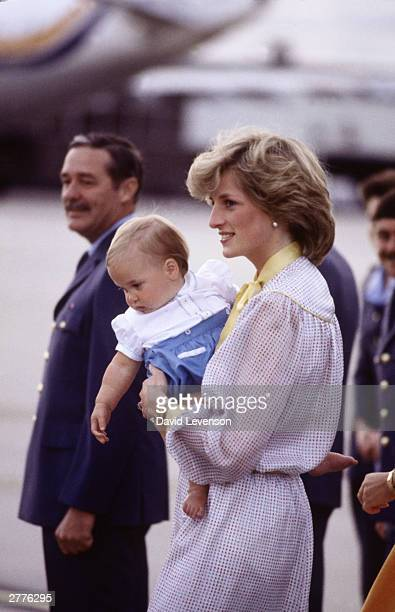 Diana Princess of Wales carries Prince William off of a plane at Melbourne Airport, Australia on April 16 at the end of the Royal Tour of Australia.
