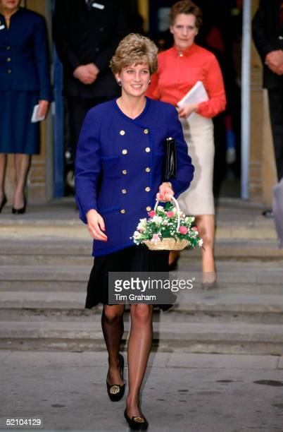 Diana Princess Of Wales Carrying A Bouquet Of Flowers At Great Ormond Street Hospital For Children Jacket Reported To Be By Fashion Designer Chanel
