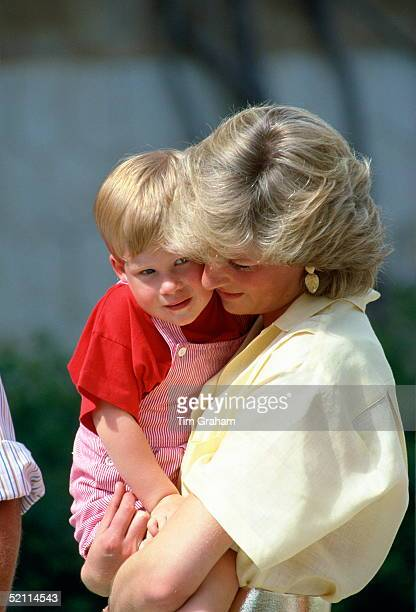 Diana Princess Of Wales Carrying Her Son Prince Harry At A Photocall During Their Summer Holiday At The Spanish Royal Palace Just Outside Palma