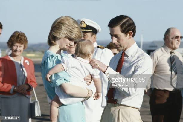 Diana Princess of Wales carrying Prince William beside Prince Charles after their arrival at Alice Springs airport for their tour of Australia 20...