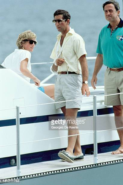 Diana Princess of Wales Charles Prince of Wales and King Constantine II of Greece on board the yacht of King Juan Carlos of Spain 'Fortuna' on summer...