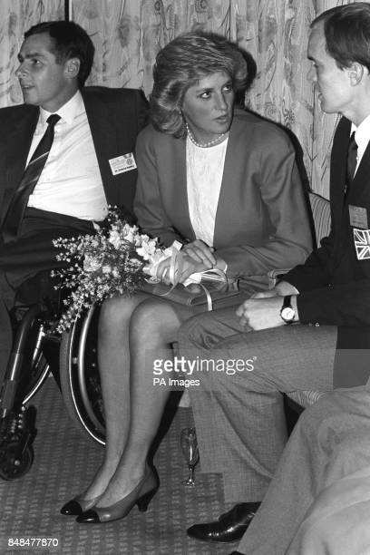 Diana Princess of Wales chats to blind athlete Bob Matthews, from Strood, Kent, flanked by disabled archer Michael Hervey-Murray, of Bishop's...