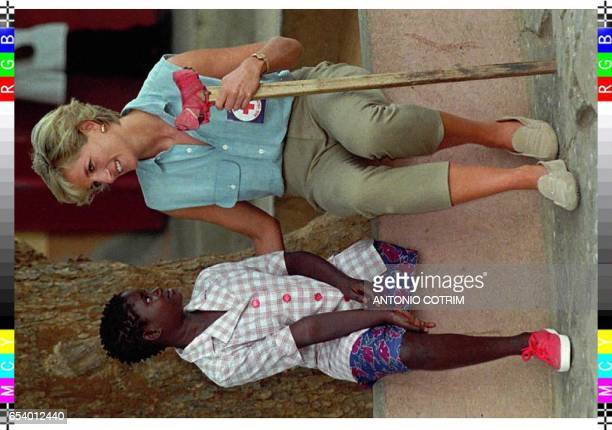 Diana Princess of Wales chats with 13years old landmine victim Sandra during a visit to the orthopaedic hospital Neves Bendinha in Luanda 14 January...
