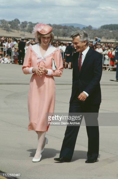 Diana, Princess of Wales chats with Australian Prime Minister Bob Hawke at RAAF Base Fairbairn in Canberra, Australia, March 1983. She is wearing a...