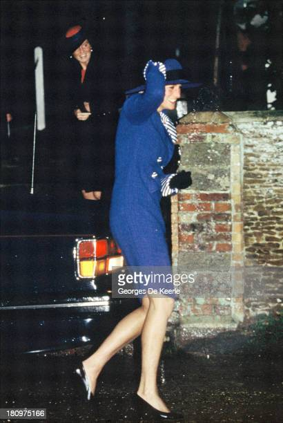 Diana Princess of Wales clutches her hat on the way to Sandringham Church for Christmas Day Service on December 25 1990 in Sandringham England