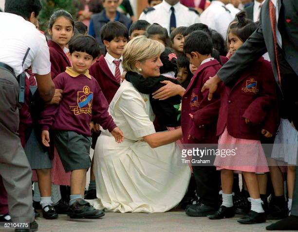 Diana Princess Of Wales Crouching Down To Embrace One Of The Many Pupils At The Swaminarayan School Whom She Met During Her Visit To The Shri...